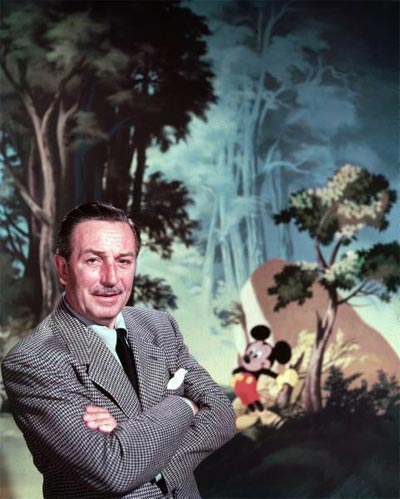 Walt Disney posing against landscape backdrop containing Mickey Mouse. 1950 photo by Alfred Eisenstaedt.