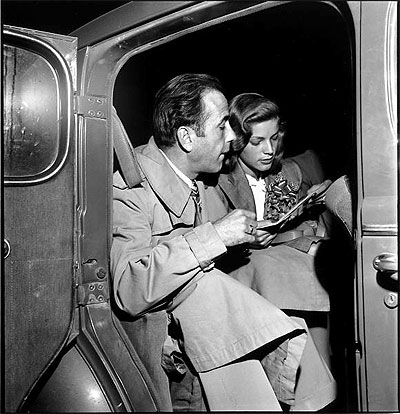 Newlywed actors Humphrey Bogart and Lauren Bacall attending wedding reception at home of novelist Louis Bromfeld. May 21, 1945 Photo by Ed Clark.