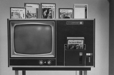 Cartrivision video tape cartridge inserted in side pocket of AVCO TV set. 1970 photo by Michael Rougier