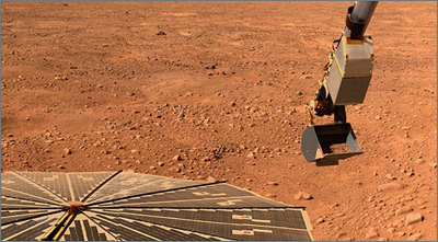 The Phoenix Mars Lander's solar panel and robotic arm in an image taken June 10, 2008.
