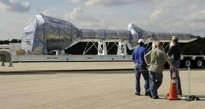 A replica of the launch abort system for the Ares 1X is taken off an Air Force C-5A Galaxy aircraft on Wednesday at the shuttle landing facility at Kennedy Space Center. The mock-up will be used in a July 11 test flight. (Michael R. Brown, FLORIDA TODAY)