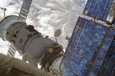 (23 Dec. 2008) --- The Progress 31 resupply vehicle remains docked to the Pirs Docking Compartment of the International Space Station, as photographed by one of the Expedition 18 crew members during a Dec. 23 spacewalk.