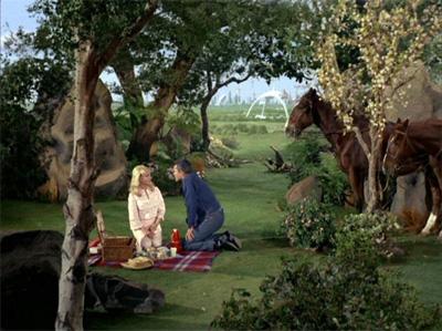 Pike and Vina enjoy an illusory picnic outside Mojave