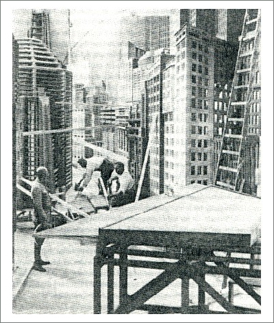Carpenters work on the construction of the skyscrapers for the movie set of Metropolis.