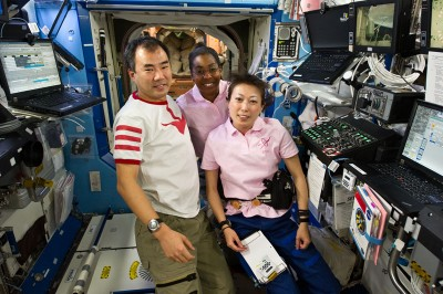 S131-E-007052 (7 April 2010) --- Japan Aerospace Exploration Agency (JAXA) astronauts Soichi Noguchi, Expedition 23 flight engineer; and Naoko Yamazaki (right), STS-131 mission specialist; along NASA astronaut Stephanie Wilson, STS-131 mission specialist, pose for a photo in the Destiny laboratory of the International Space Station while space shuttle Discovery remains docked with the station.