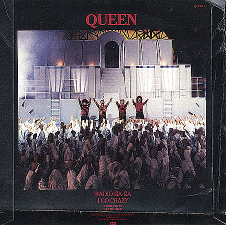 Above the record sleeve for the queen single radio ga ga the music