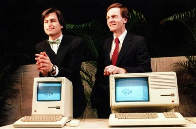 Steve Jobs on the left and John Sculley on the right from the early 80s with a Mac and a Lisa