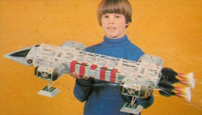 A 70s child holding an Eagle toy from Space:1999